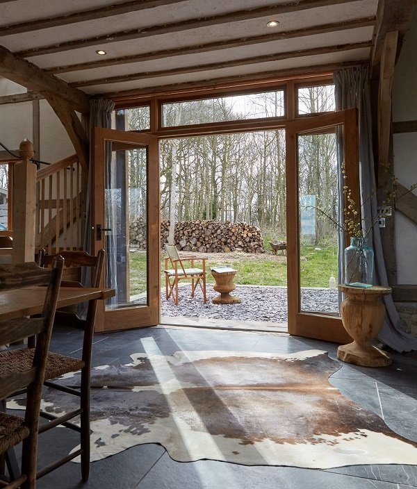 Light streams into the barn conversion via the barn doors
