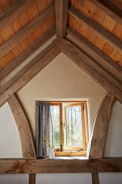 A beautiful view is framed by oak beams in this barn conversion